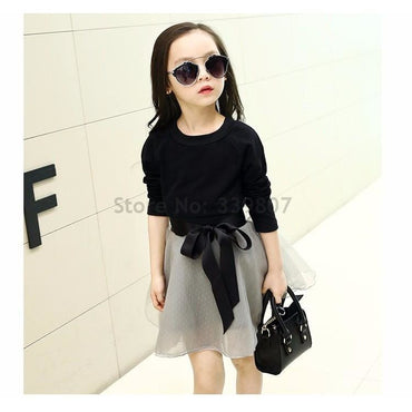 Little girl wearing chic tutu skirt and long-sleeved t-shirt