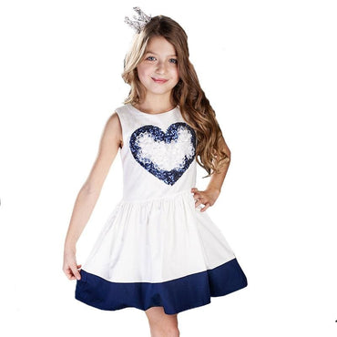 Little girl wearing white dress with blue heart and hem
